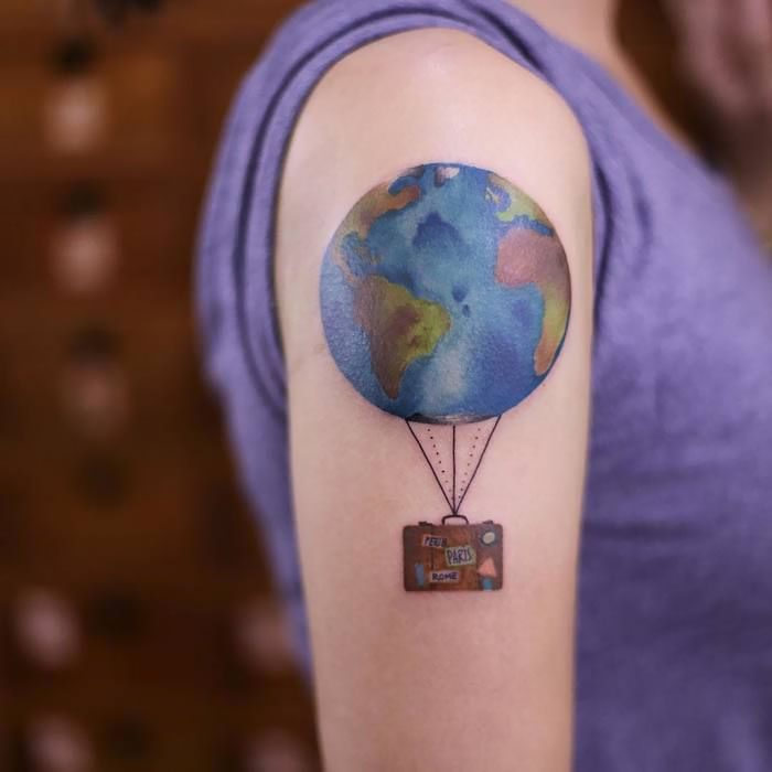 tatuaje de globo terráqueo